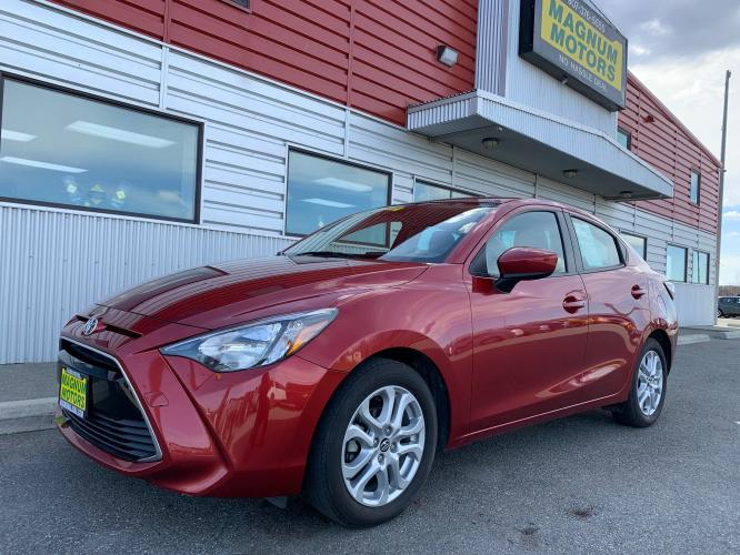 2018 Red /Black Toyota Yaris iA 6A (3MYDLBYV5JY) with an 1.5L L4 DOHC 16V engine, 6A transmission, located at 1960 Industrial Drive, Wasilla, AK, 99654, (907) 376-5555, 61.573475, -149.400146 - Photo #0