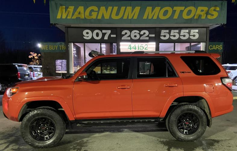 2015 Red /Black Toyota 4Runner SR5 4WD (JTEBU5JR5F5) with an 4.0L V6 DOHC 24V engine, 5-Speed Automatic transmission, located at 44152 Sterling Highway, Soldotna, AK, 99669, (907) 262-5555, 60.484917, -151.062408 - Photo #0