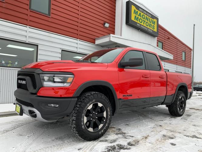 2019 Red /Black/Red RAM 1500 Rebel Quad Cab 4WD (1C6SRFET0KN) with an 3.6L V6 FFV engine, 8A transmission, located at 1960 Industrial Drive, Wasilla, AK, 99654, (907) 376-5555, 61.573475, -149.400146 - Photo #0