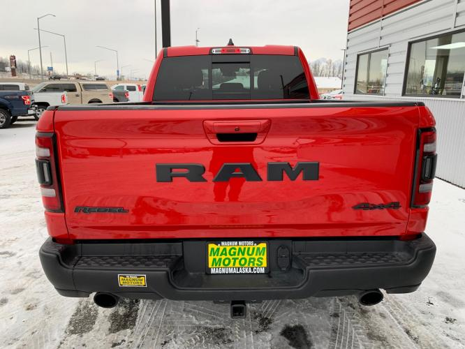 2019 Red /Black/Red RAM 1500 Rebel Quad Cab 4WD (1C6SRFET0KN) with an 3.6L V6 FFV engine, 8A transmission, located at 1960 Industrial Drive, Wasilla, AK, 99654, (907) 376-5555, 61.573475, -149.400146 - Photo #4