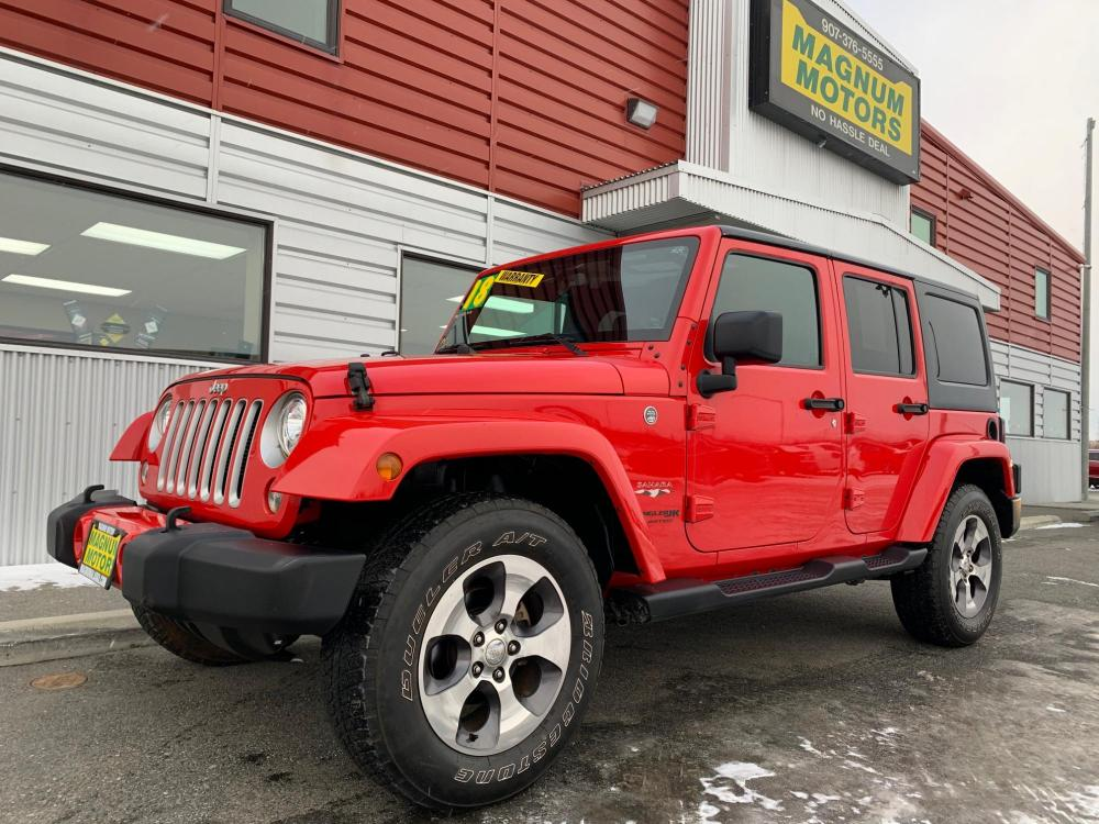2018 Red /Black Jeep Wrangler Unlimited Sahara 4WD (1C4HJWEG3JL) with an 3.6L V6 DOHC 24V FFV engine, Automatic transmission, located at 44152 Sterling Highway, Soldotna, 99669, (907) 262-5555, 60.484917, -151.062408 - Photo #0