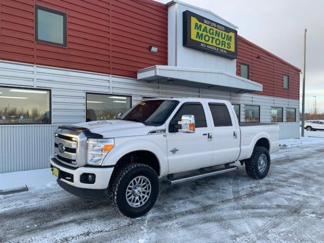 2015 White /Black Ford F-350 SD Platinum Crew Cab 4WD (1FT8W3BT9FE) with an 6.7L V8 OHV 16V DIESEL engine, 6-Speed Automatic transmission, located at 1960 Industrial Drive, Wasilla, AK, 99654, (907) 376-5555, 61.573475, -149.400146 - Photo #0