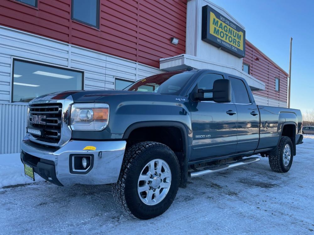 2015 Blue /Gray GMC Sierra 3500HD SLE Double Cab Long Box 4WD (1GT522C89FZ) with an 6.6L V8 OHV 16V DIESEL engine, 6-Speed Automatic transmission, located at 44152 Sterling Highway, Soldotna, 99669, (907) 262-5555, 60.484917, -151.062408 - Photo #0